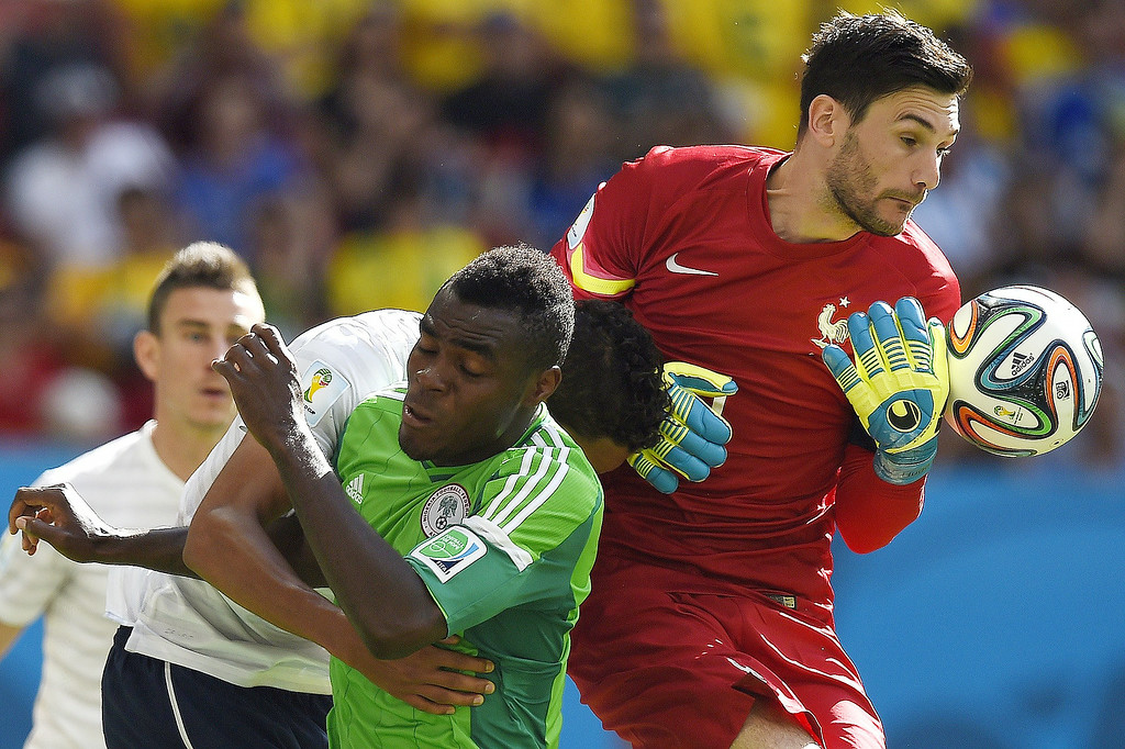 . France\'s goalkeeper and captain Hugo Lloris (R) and Nigeria\'s forward Emmanuel Emenike vie for the ball during a Round of 16 football match between France and Nigeria at Mane Garrincha National Stadium in Brasilia during the 2014 FIFA World Cup on June 30, 2014.  ODD ANDERSEN/AFP/Getty Images