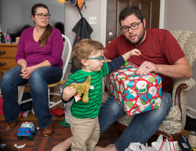 Jesse Caleb and Holly opening present.jpg