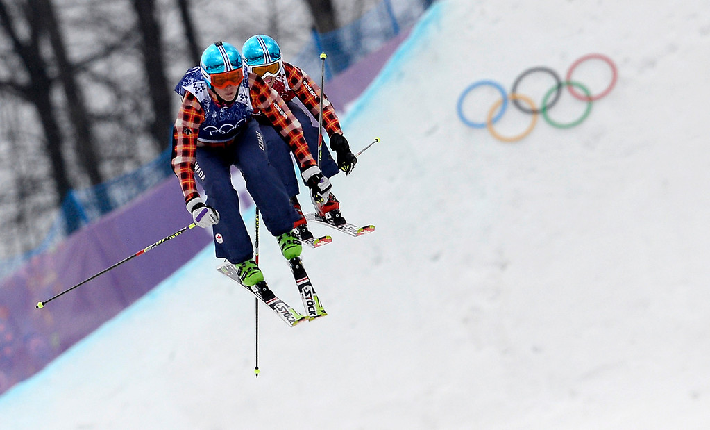 . Gold Medallist, Canada\'s Marielle Thompson (L) and Silver Medallist, Canada\'s Kelsey Serwa race in the Women\'s Freestyle Skiing Ski Cross Final at the Rosa Khutor Extreme Park during the Sochi Winter Olympics on February 21, 2014.  FRANCK FIFE/AFP/Getty Images