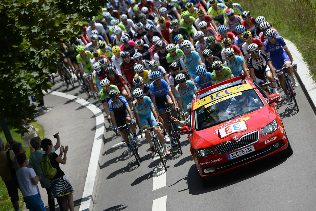 . Riders take the start of the 187.5 km eleventh stage of the 101st edition of the Tour de France cycling race on July 16, 2014 between Besancon and Oyonnax, eastern France.  AFP PHOTO / LIONEL BONAVENTURE/AFP/Getty Images