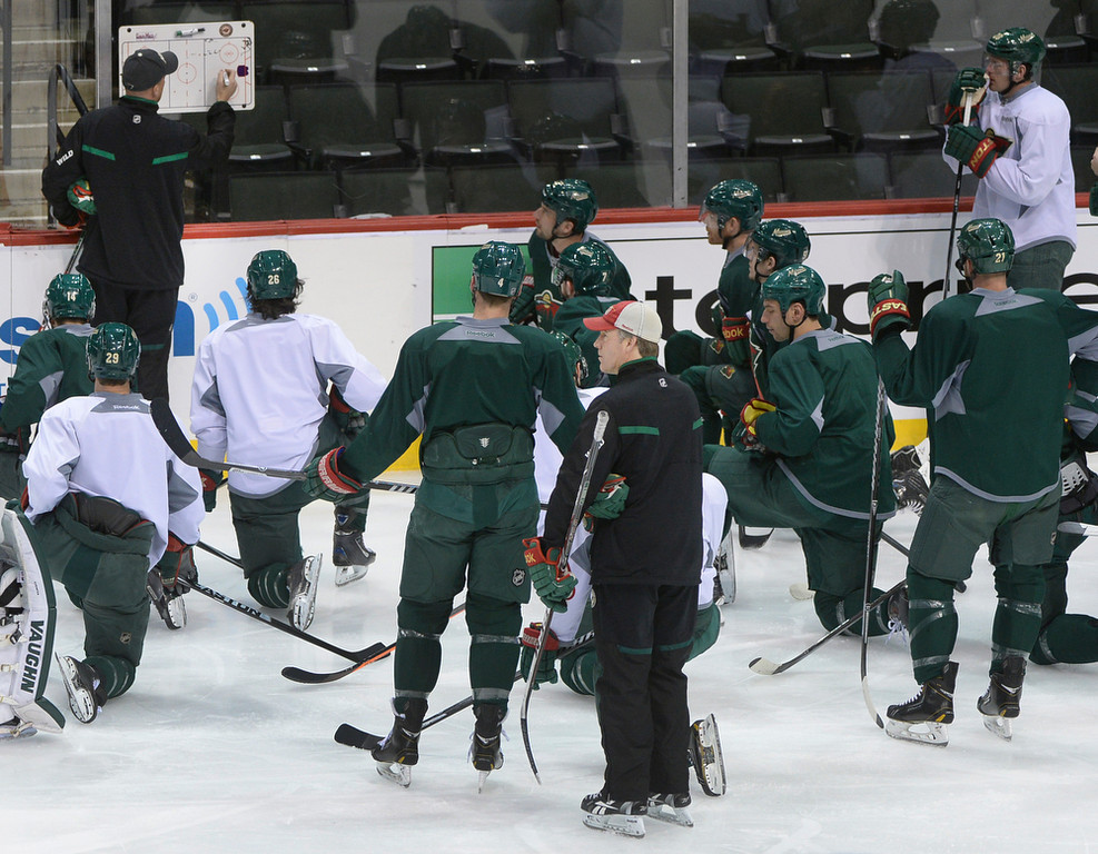 . Minnesota Wild coach Mike Yeo used a board to diagram plays he wanted to work on during practice Wednesday morning, April 23, 2014 in St. Paul. (Photo by Karl Gehring/The Denver Post)