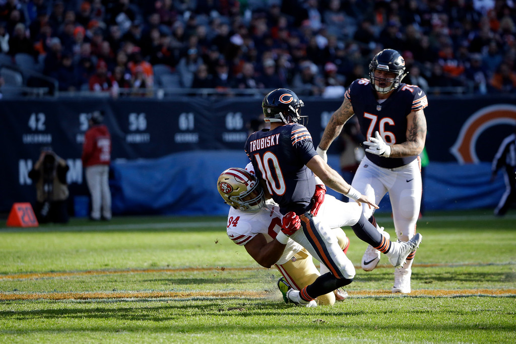 . San Francisco 49ers defensive end Solomon Thomas (94) tackles Chicago Bears quarterback Mitchell Trubisky (10) during the second half of an NFL football game, Sunday, Dec. 3, 2017, in Chicago. (AP Photo/Nam Y. Huh)