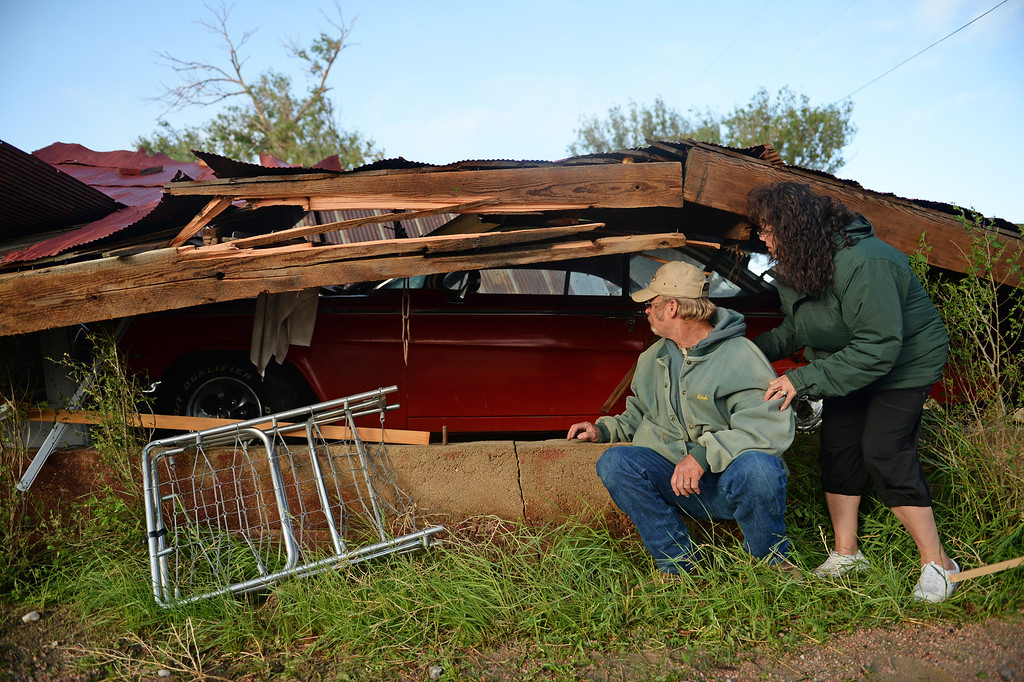 . Richard and Jennie Hoefler check out the damage to their barn that was destroyed in Hugo after a lager storm moved through town over night, June 5, 2014. Inside the barn was a vintage car that the two took to prom.  (Photo by RJ Sangosti/The Denver Post)