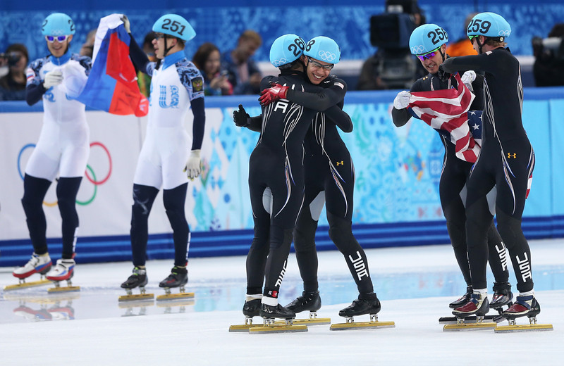 . Members of the United States short track team celebrate winning the silver medal in the Short Track Men\'s 5000m Relay on day fourteen of the 2014 Sochi Winter Olympics at Iceberg Skating Palace on February 21, 2014 in Sochi, Russia.  (Photo by Matthew Stockman/Getty Images)