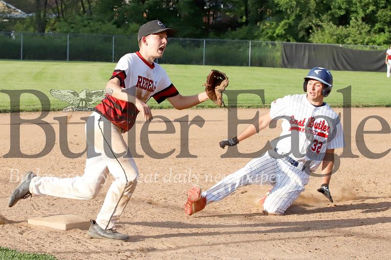 East Butler's Cody Schnur beat's a throw to Center Township third baseman Jason Grigoletti. Seb Foltz/Butler Eagle