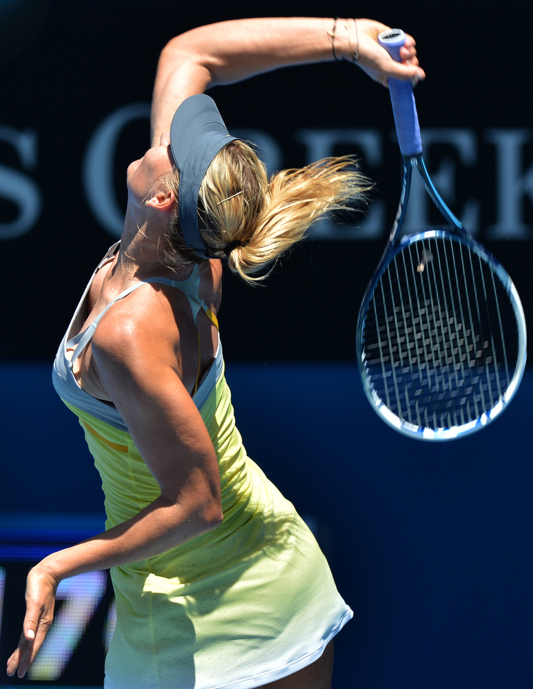 . Russia\'s Maria Sharapova serves during her women\'s singles semi-final match against China\'s Li Na on the eleventh day of the Australian Open tennis tournament in Melbourne on January 24, 2013.   PAUL CROCK/AFP/Getty Images