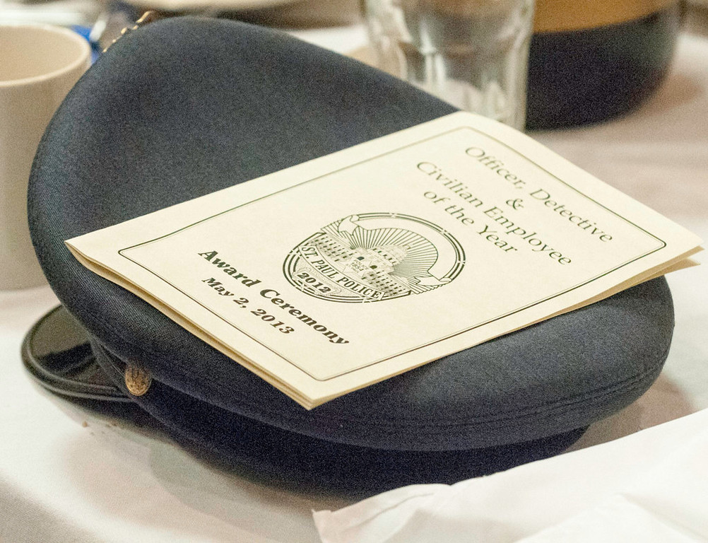 . A program lays on top of an officer\'s hat at the ceremony. (Pioneer Press: Chris Polydoroff)