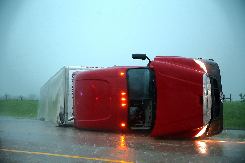 . An overturned semitrailer rests on its side on the eastbound lanes of Interstate 40, just east of El Reno, Okla., after a reported tornado touched down, Friday, May 31, 2013. (AP Photo/The Omaha World-Herald, Chris Machian)
