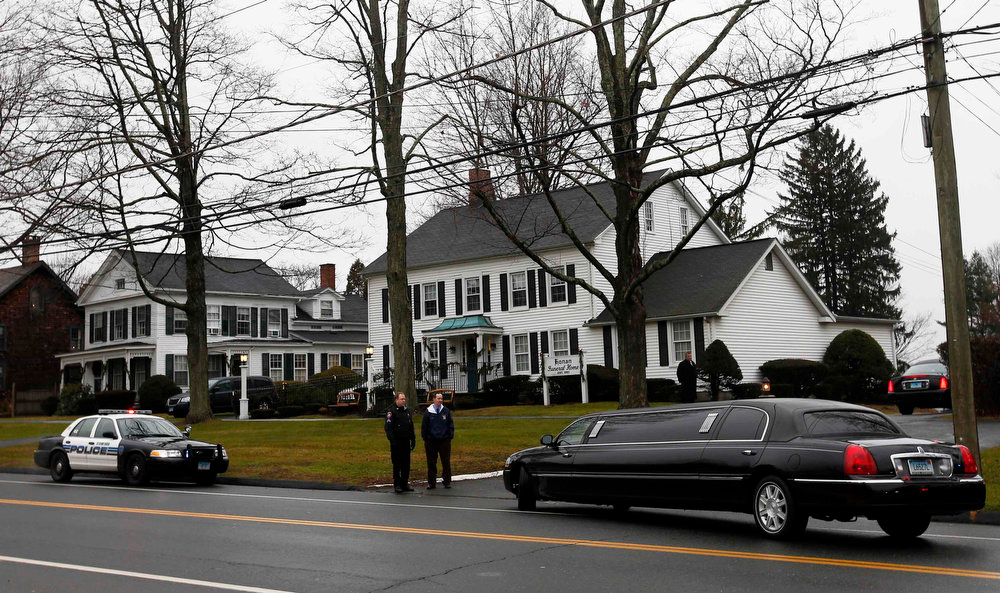 . A limousine arrives at Honan Funeral Home, where the family of six-year-old Jack Pinto is holding his funeral service, in Newtown, Connecticut December 17, 2012. Pinto was one of the 20 students killed in the December 14 shootings at Sandy Hook Elementary School in Newtown.  REUTERS/Mike Segar