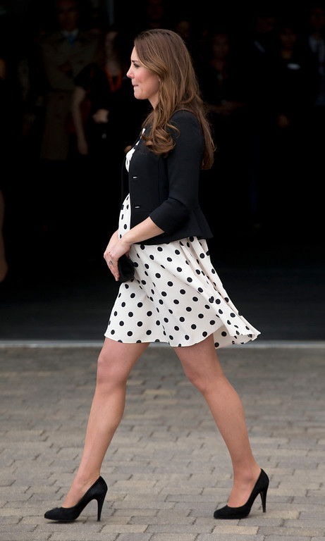 ". Kate the Duchess of Cambridge, her husband Prince William and his brother Prince Harry, both not pictured, leave after attending the inauguration of ""Warner Bros. Studios Leavesden\"" near Watford, approximately 18 miles north west of central London, Friday, April 26, 2013.(AP Photo/Matt Dunham)"