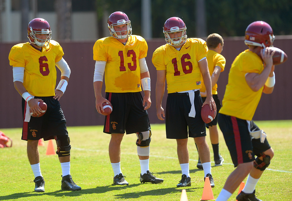 . Quarterbacks work out during practice at USC August 20, 2013.(Andy Holzman/Los Angeles Daily News)