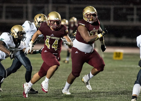 11/09/18 Wesley Bunnell | Staff New Britain vs Enfield at Veterans Stadium on Friday night. Isaiah Medina (44) and Devon Bishop (59) pursue the quarterback.