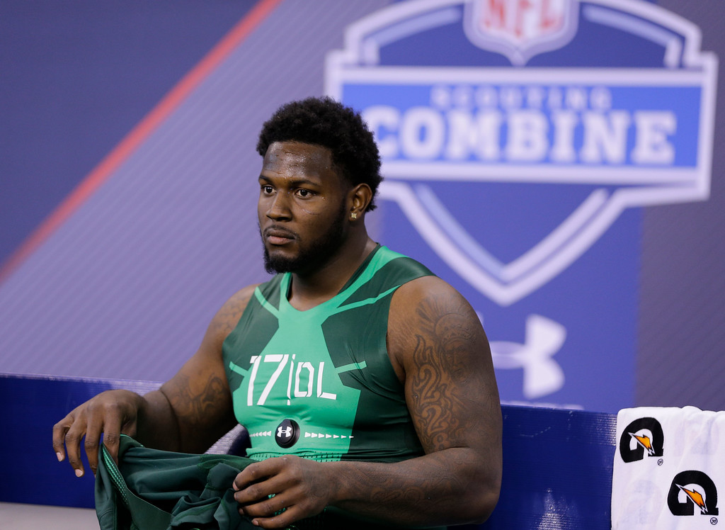 . Florida State defensive lineman Mario Edwards sits on the bench after a drill at the NFL football scouting combine in Indianapolis, Sunday, Feb. 22, 2015. (AP Photo/David J. Phillip)