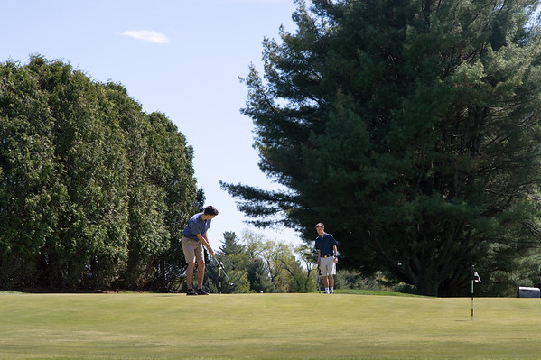 05/6/19 Wesley Bunnell | Staff Matthew Pepper, L and Derek Delaney, both members of CCSU's club golf team practice their putting at Stanley Golf Course on a bright and sunny Monday afternoon.