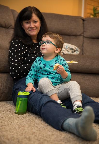 Caleb Watching TV on Mimis lap.jpg