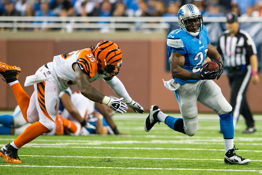. DETROIT, MI - OCTOBER 20: Outside linebacker Vontaze Burfict #55 of the Cincinnati Bengals tries to tackle running back Reggie Bush #21 of the Detroit Lions during the first half at Ford Field on October 20, 2013 in Detroit, Michigan. (Photo by Jason Miller/Getty Images)