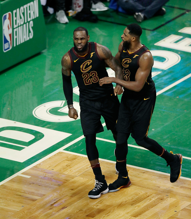 . Cleveland Cavaliers forward LeBron James and center Tristan Thompson (13) celebrate near the end of the second half in Game 7 of the NBA basketball Eastern Conference finals, Sunday, May 27, 2018, in Boston. (AP Photo/Charles Krupa)