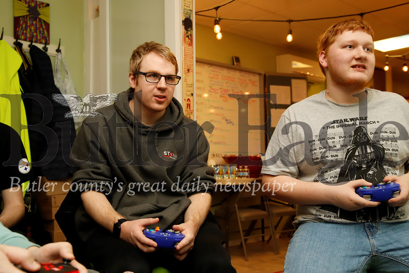Stephen Matousek and Aaron Bennett compete in a round of Smash Brothers at Parents in Toto's community center game day Saturday. The Zelienople-based non-profit offers a community center and resources for teens and young adults with Autism and their families. Seb Foltz/Butler