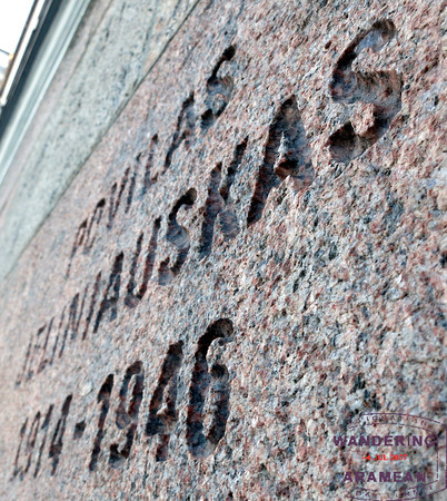 One of the many names carved into the facade of the building, reminding visitors of those who perished inside.