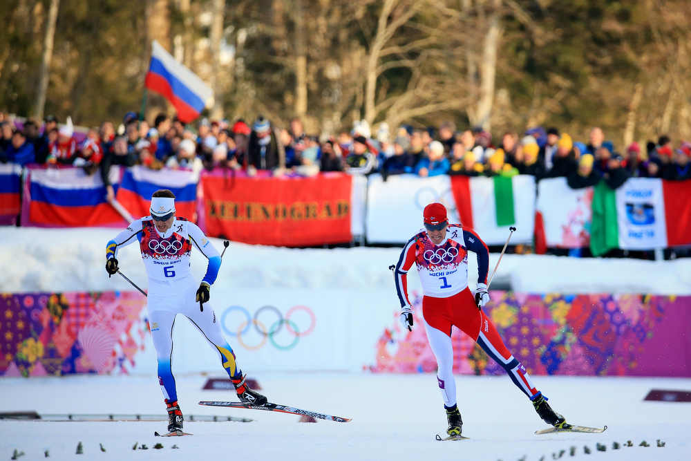 . Teodor Peterson of Sweden (L) and Ola Vigen Hattestad of Norway compete in Finals of the Men\'s Sprint Fee during day four of the Sochi 2014 Winter Olympics at Laura Cross-country Ski & Biathlon Center on February 11, 2014 in Sochi, Russia.  (Photo by Richard Heathcote/Getty Images)