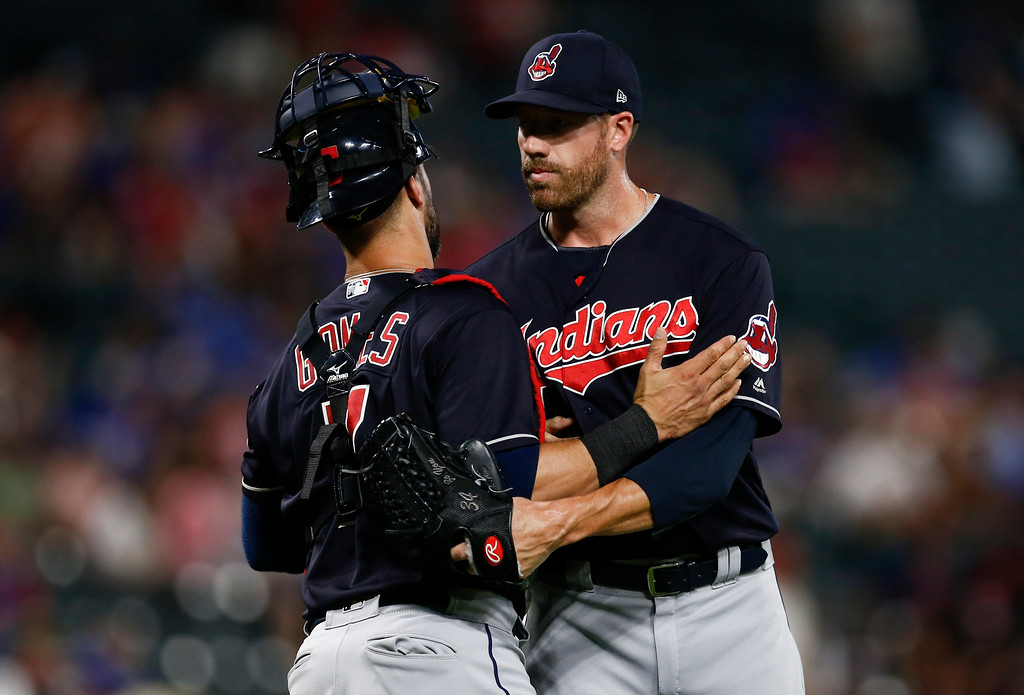 . Cleveland Indians relief pitcher Zach McAllister, right, and catcher Yan Gomes (7) congratulate each other following their team\'s 16-3 win over the Texas Rangers during a baseball game, Saturday, July 21, 2018, in Arlington, Texas. (AP Photo/Jim Cowsert)