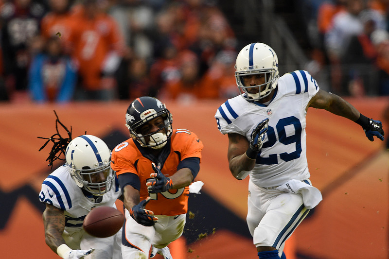 . Emmanuel Sanders (10) of the Denver Broncos stretches for a pass out of his reach. The Denver Broncos played the Indianapolis Colts in an AFC divisional playoff game at Sports Authority Field at Mile High in Denver on January 11, 2015. (Photo by Joe Amon/The Denver Post)