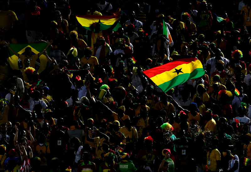. Fans from Ghana wave their nation\'s flag in the stands before the group G World Cup soccer match between Ghana and the United States at the Arena das Dunas in Natal, Brazil, Monday, June 16, 2014.  (AP Photo/Petr David Josek)