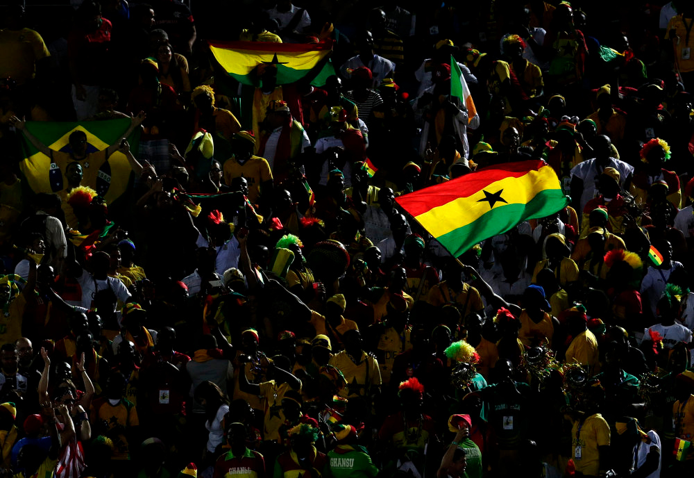 Description of . Fans from Ghana wave their nation's flag in the stands before the group G World Cup soccer match between Ghana and the United States at the Arena das Dunas in Natal, Brazil, Monday, June 16, 2014.  (AP Photo/Petr David Josek)