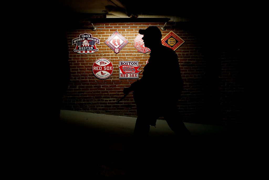 . A fan walks inside Fenway Park before Game Two of the 2013 World Series between the St. Louis Cardinals and the Boston Red Sox on October 24, 2013 in Boston, Massachusetts.  (Photo by Elsa/Getty Images)
