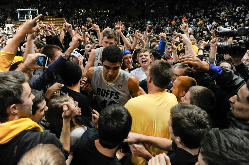 . Colorado University fans rushed the court after CU defeated Kansas at the buzzer 75-72 at the Coors Events Center in Boulder Colorado Saturday afternoon, December 07, 2013. (Photo By Andy Cross/The Denver Post)