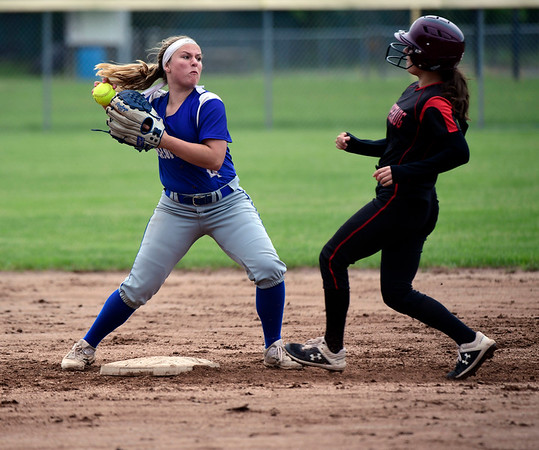 5/30/2019 Mike Orazzi | Staff Bristol Eastern's Alison Tellier (4) forces out Pomperaug's Emily Carvalho (10) during the Class L Second Round softball game in Bristol Thursday.