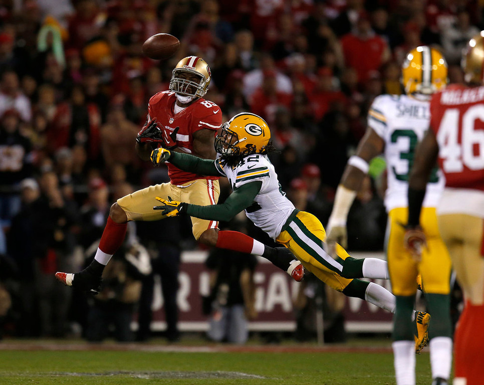 . The Green Bay Packers\' Morgan Burnett (42) breaks up a pass intended for the San Francisco 49ers\' Vernon Davis (85) in the second quarter in the NFC Divisional Playoff on Saturday, January 12, 2013, at Candlestick Park in San Francisco, California. (Nhat V. Meyer/San Jose Mercury News)