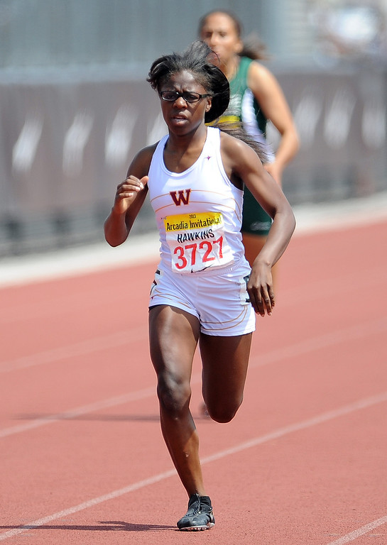 . Wilson\'s (Long Beach) Kaila Hawkins competes in the 400 meters race in the during the Arcadia Invitational at Arcadia High School on Saturday, April 6, 2013 in Arcadia, Calif.  (Keith Birmingham Pasadena Star-News)