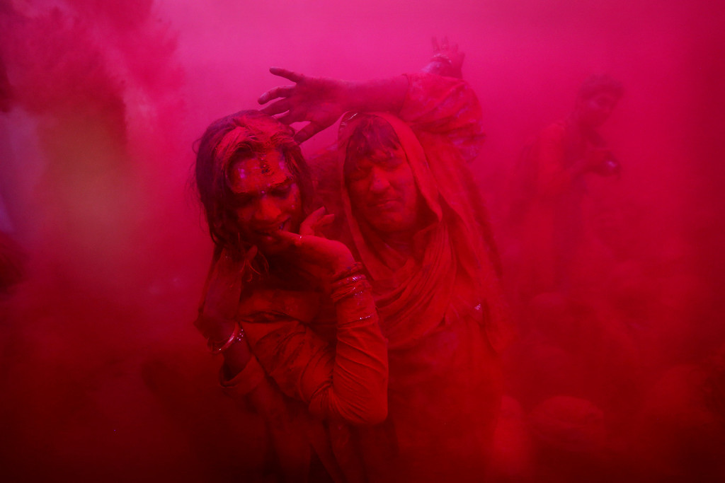 . Hindu transsexuals or Eunuchs dance as colored powder is thrown at the Ladali or Radha temple before the procession for the Lathmar Holy festival, the legendary hometown of Radha, consort of Hindu God Krishna, in Barsana, 115 kilometers (71 miles) from New Delhi, India, Thursday, March 21, 2013. During Lathmar Holi the women of Barsana beat the men from Nandgaon, the hometown of Krishna, with wooden sticks in response to their teasing as they depart the town. (AP Photo/Kevin Frayer)