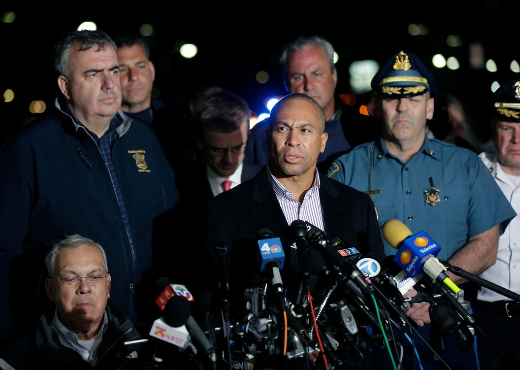. Massachusetts Governor Deval Patrick, at podium, speaks during a news conference, after the arrest of a suspect of the Boston Marathon bombings in Watertown, Mass., Friday, April 19, 2013. A 19-year-old college student wanted in the Boston Marathon bombings was taken into custody Friday evening after a manhunt that left the city virtually paralyzed and his older brother and accomplice dead.  (AP Photo/Matt Rourke)