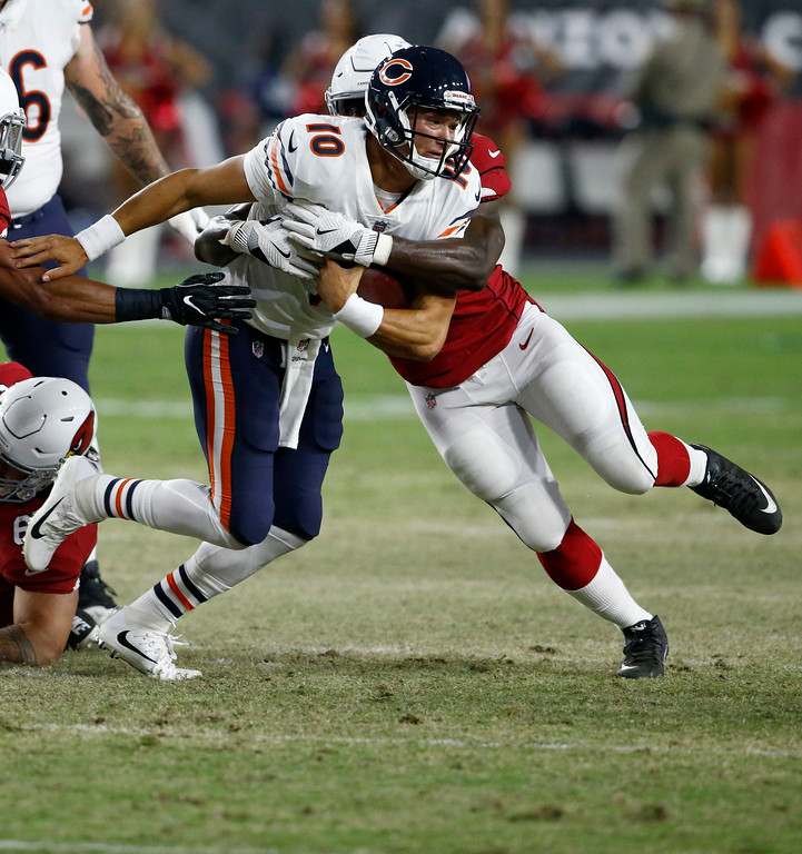 . Chicago Bears quarterback Mitchell Trubisky (10) is sacked by Arizona Cardinals linebacker Alex Bazzie, right, during the second half of a preseason NFL football game, Saturday, Aug. 19, 2017, in Glendale, Ariz. (AP Photo/Ross D. Franklin)