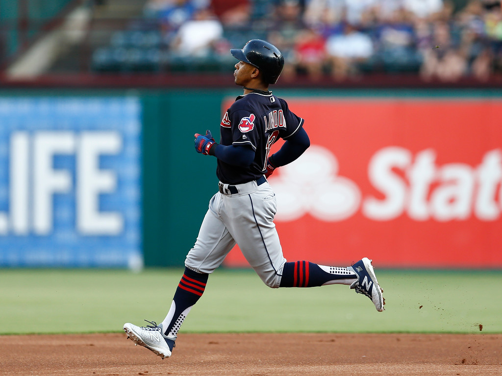 . Cleveland Indians\' Francisco Lindor runs to second on his lead-off double against the Texas Rangers during the first inning of a baseball game, Saturday, July 21, 2018, in Arlington, Texas. (AP Photo/Jim Cowsert)