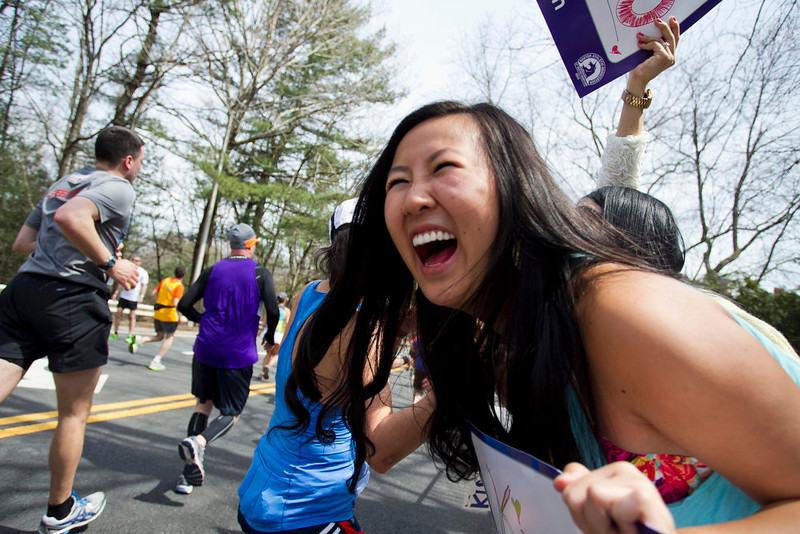 . Supporters cheer on participants in the 117th running of the Boston Marathon in Wellesley, Massachusetts April 15, 2013. REUTERS/Dominick Reuter