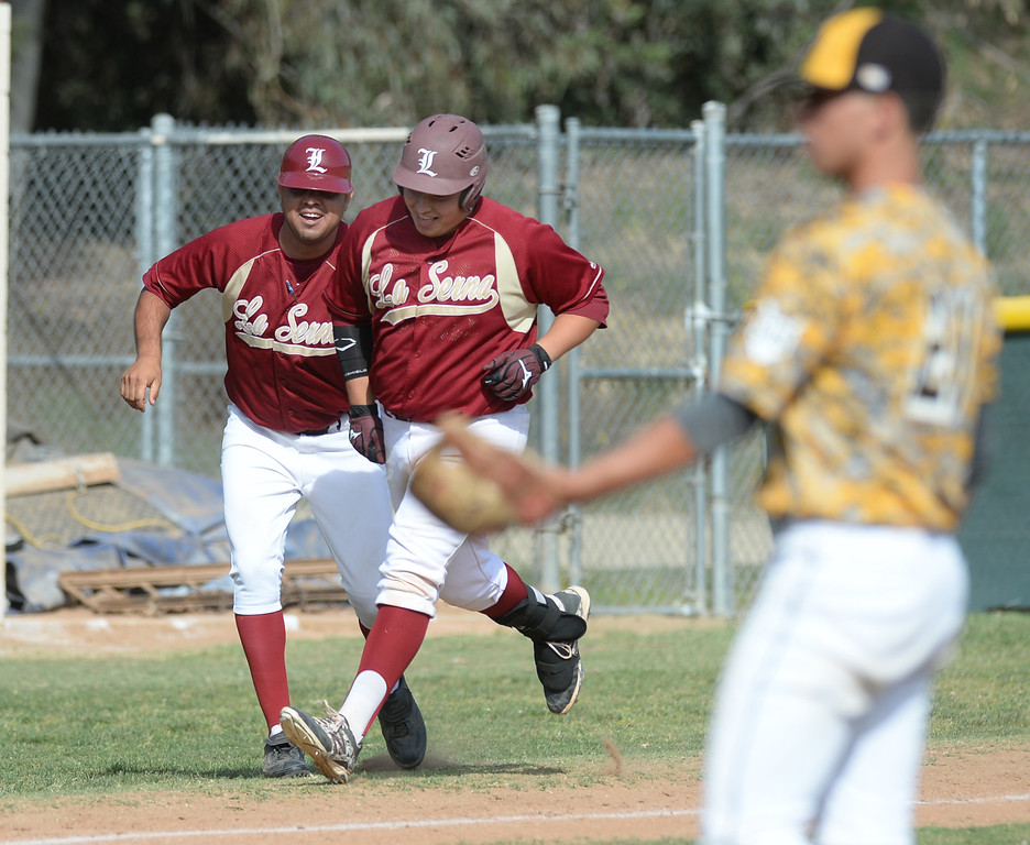 . La Serna\'s John Mendoza (#38) is congratulated by head coach Anthony Gonzales after hitting a three-run homerun as they play Sata Fe in their Del Rio League game at La Serna High School in Whittier on Wednesday April 23, 2014. (Staff Photo by Keith Durflinger/Whittier Daily News)