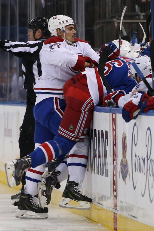 . Rene Bourque #17 of the Montreal Canadiens checks Anton Stralman #6 of the New York Rangers into the boards during Game Six of the Eastern Conference Final in the 2014 NHL Stanley Cup Playoffs at Madison Square Garden on May 29, 2014 in New York City.  (Photo by Bruce Bennett/Getty Images)