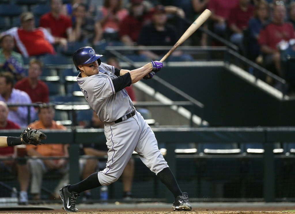 . Jordan Pacheco #58 of the Colorado Rockies hits a double against the Arizona Diamondbacks during the second inning of the MLB game at Chase Field on April 30, 2014 in Phoenix, Arizona.  (Photo by Christian Petersen/Getty Images)