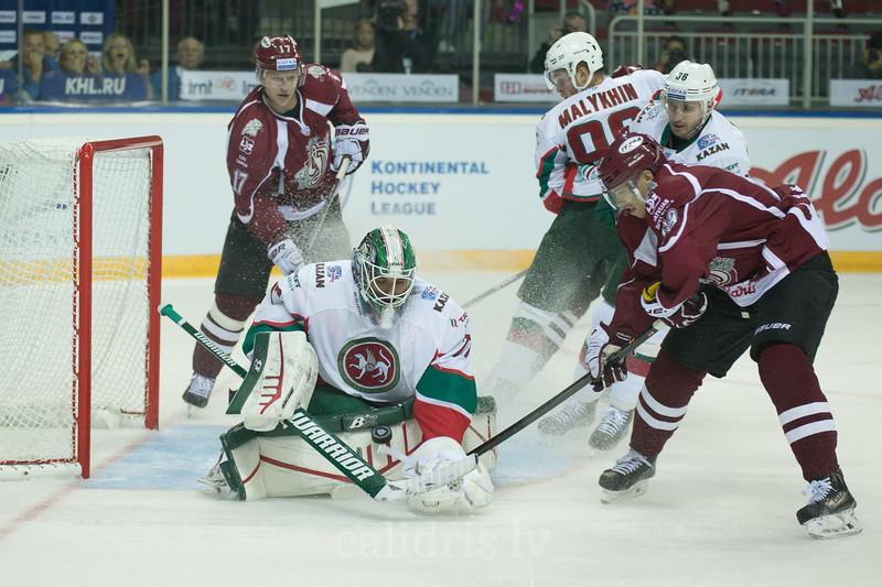 Goaltender of Ak Bars Emil Garipov (77) saves the goal