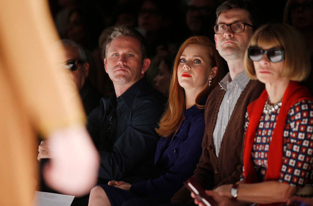 . Actress Amy Adams, third from right, and Anna Wintour editor-in-chief of American Vogue, right, attend Max Mara women\'s spring-summer 2015 fashion show, part of the Milan Fashion Week, unveiled in Milan, Italy, Thursday, Sept. 18, 2014. (AP Photo/Luca Bruno)