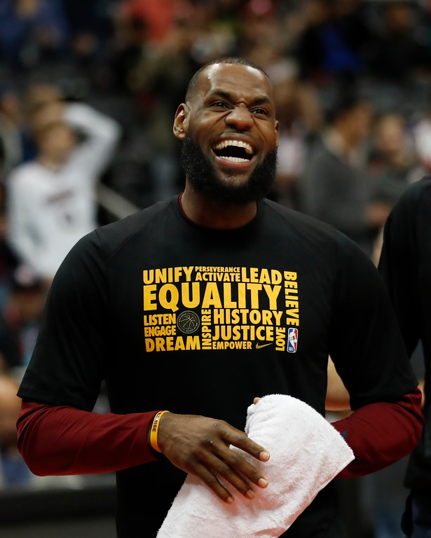 . Cleveland Cavaliers forward LeBron James (23) laughs with teammates as they warm up before in the first half of an NBA basketball game against the Atlanta Hawks Friday, Feb. 9, 2018, in Atlanta. (AP Photo/John Bazemore)