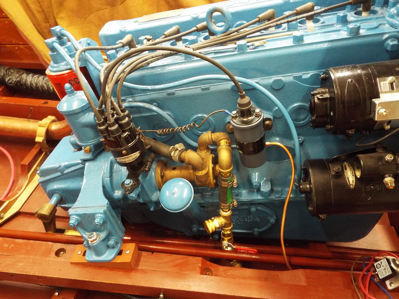 Custom water intake. You can use a garden hose or a bottom cup to run the engine out of the water. Can also winterize from the T connection.
