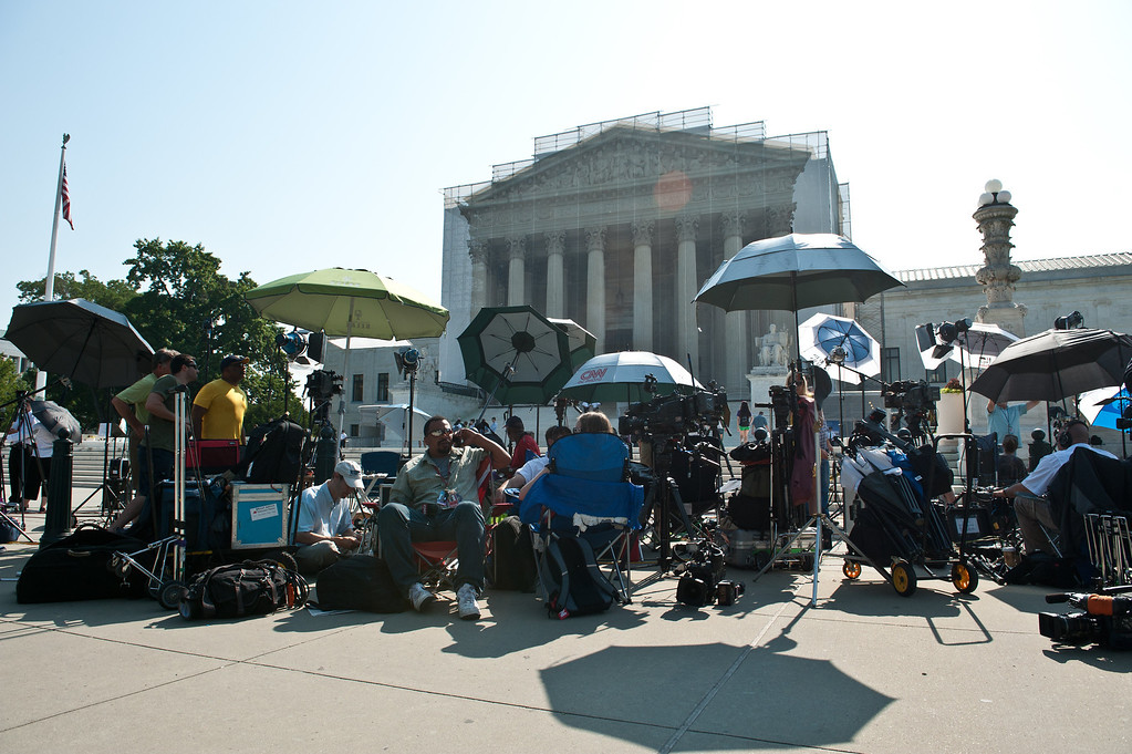 . Television news crews gather in front of the US Supreme Court in Washington,DC on June 25, 2013.   The high court convened again today to rule on some high profile decisions including including two on gay marriage and one on voting rights.  NICHOLAS KAMM/AFP/Getty Images