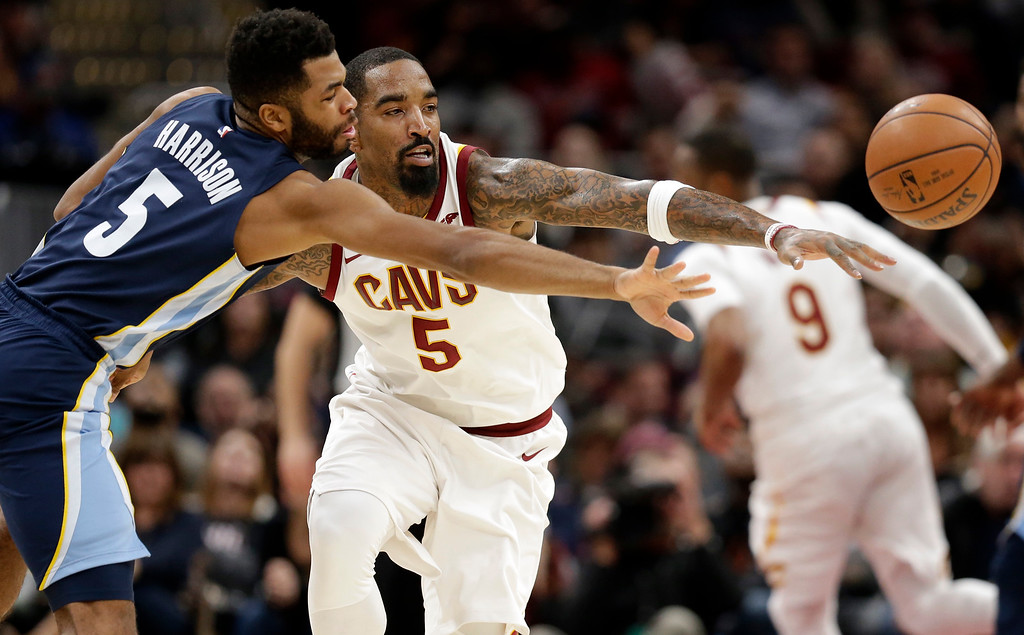 . Memphis Grizzlies\' Andrew Harrison, left, and Cleveland Cavaliers\' JR Smith battle for the ball in the second half of an NBA basketball game, Saturday, Dec. 2, 2017, in Cleveland. (AP Photo/Tony Dejak)