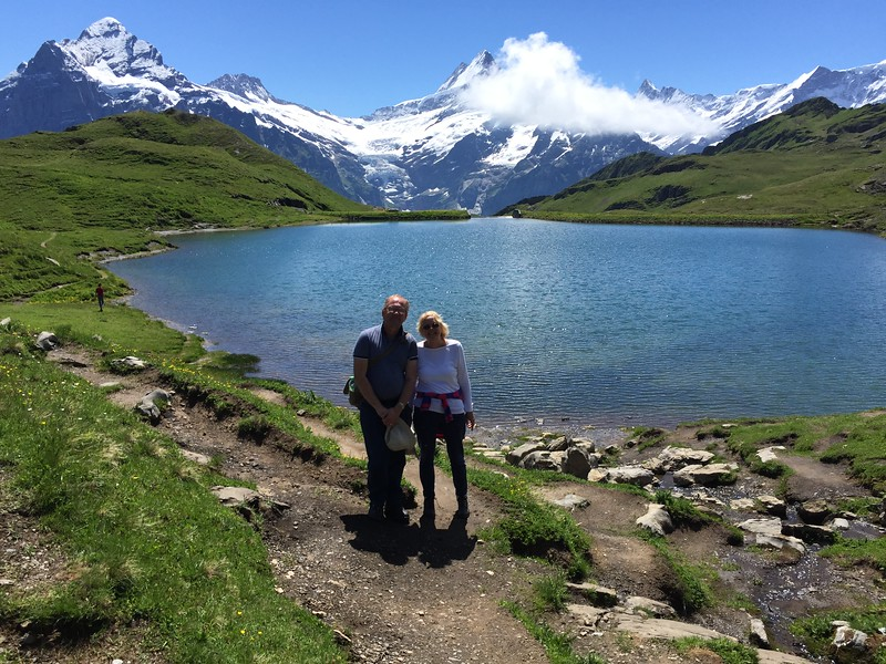 View of Lake Bachalpsee surrounded by mountains while hiking the swiss alps.