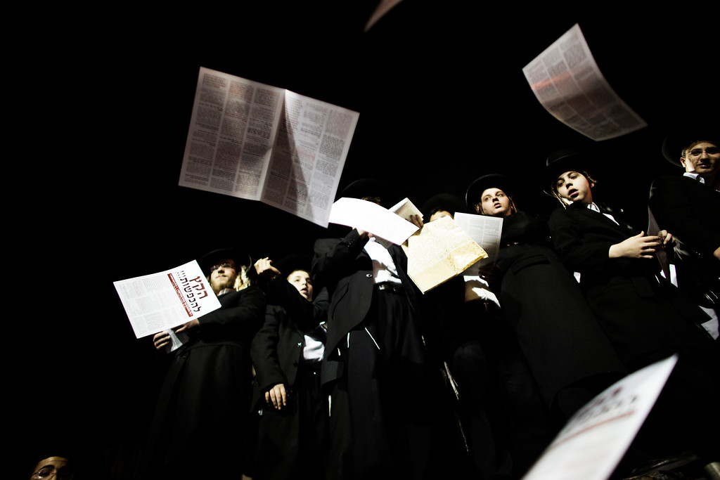 """. Anti draft leaflets are thrown in the air as thousands Orthodox Jews gather in front of the main army recruitment office in Jerusalem on May 16, 2013 to demonstrate against any plans to make them undergo military service, a police spokesman said.  Protesters also prayed and chanted \""""the Torah above everything!\"""" referring to Jewish religious law, and \""""the army will not take yeshiva (religious seminary) pupils.\""""  MARCO LONGARI/AFP/Getty Images"""