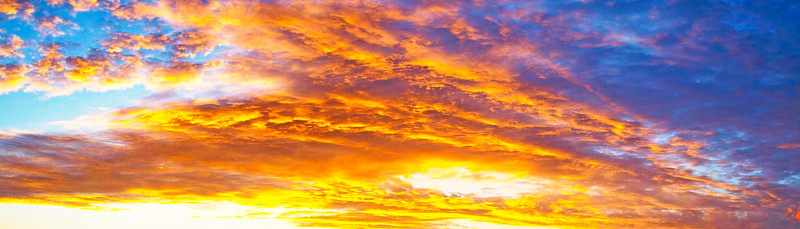 Red colored cirrus cloud, background sunset seascape.
